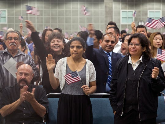 Guadalupe Gonzalez, front center, joins other immigrants taking the citizenship oath during naturalization ceremonies at a U.S. Citizenship and Immigration Services ceremony in Los Angeles on Wednesday.