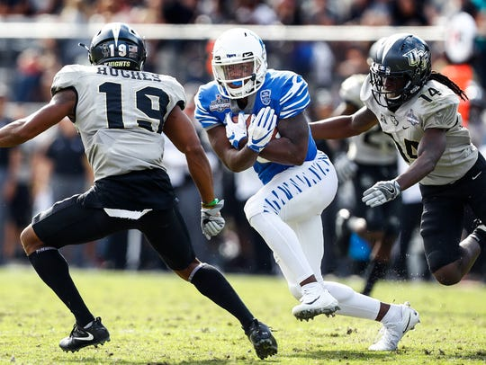 Memphis tight end Sean Dykes (middle) scrambles for