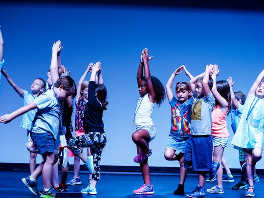 Campers play charades during a session at Graceland