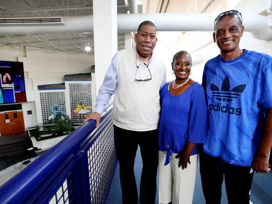 Ron Washington, left, Gloria Bonner, center, and Pierre Lyons, right all stand on the track at Patterson Park Community Center, named for community leader Dr. James Patterson, who died in 1969.