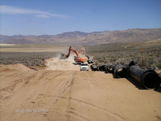 Excavation work is done in Dry Valley in June 2007 as part of the North Valleys Importation Project.