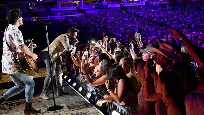 Dan + Shay get close to their fans at the CMA Music Festival on June 7, 2018, at Nissan Stadium in Nashville.