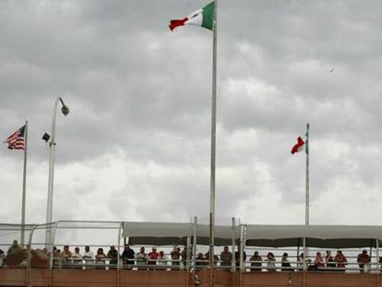People standing on the Paso Del Norte border bridge