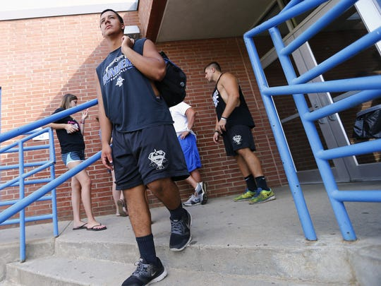 Varsity players leave after the Sayreville High School football's Monday workout. The program was shut down last season following allegations of locker room misconduct and returns to action under new head coach Chris Beagan.