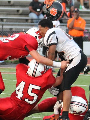 Withrow running back Isaiah Murph gets his helmet popped off followed by a blow to the head. He would stay in the game, though.