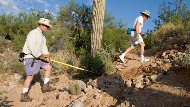 Steve Gadd (left) and Chet Andrews  work on one of the trails near Sunrise Trailhead of the McDowell Sonoran Preserve in 2005.