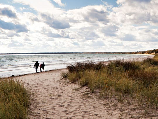 Whitefish Dunes State Park features a sandy beach along