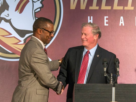 Willie Taggart, left, is greeted by Florida State University