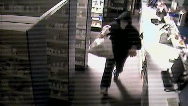 Surveillance footage shows a suspect walking through the Stuarts Draft Family Pharmacy during a break-in on Saturday, May 30, 2015.