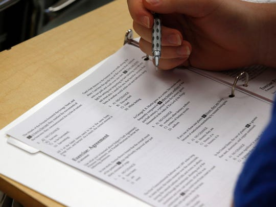 A student takes on questions during a college test preparation class.
