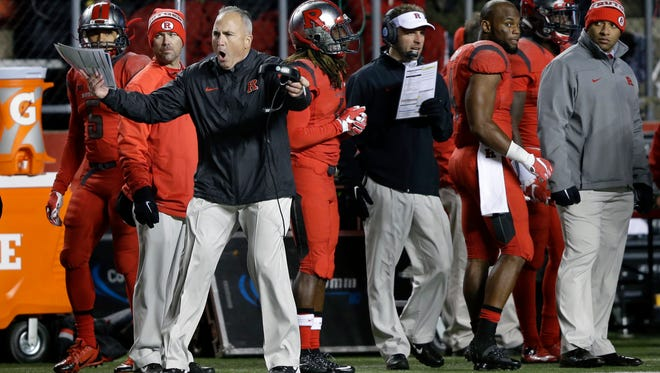 Rutgers coach Kyle Flood, front left, reacts to a call during the second half of an NCAA college football game against Nebraska, Saturday, Nov. 14, 2015, in Piscataway, N.J. (AP Photo/Mel Evans)