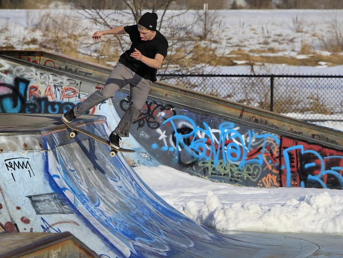 Alex Helvie, 18, Indianapolis, skateboards in his short sleeves at the skate park next to Major Taylor Velodrome on Cold Spring Road on Wednesday, February 19, 2014. Temperatures late Wednesday afternoon were in the mid-40s.