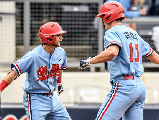 Ole Miss' Chase Cockrell, right, is congratulated by