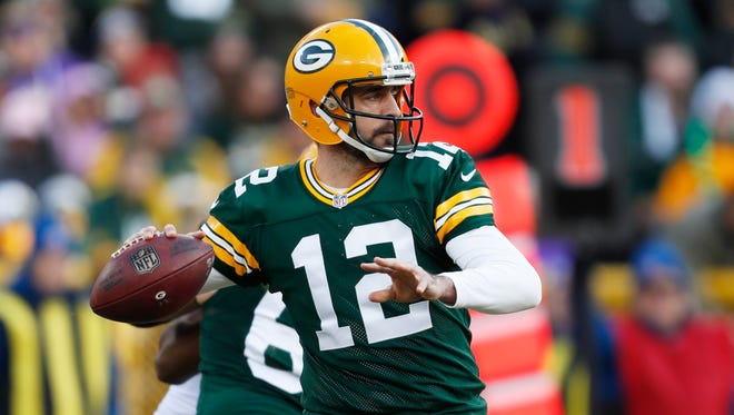 Green Bay Packers' Aaron Rodgers throws during the first half of an NFL football game Dec. 24, 2016 against the Minnesota Vikings in Green Bay, Wis.