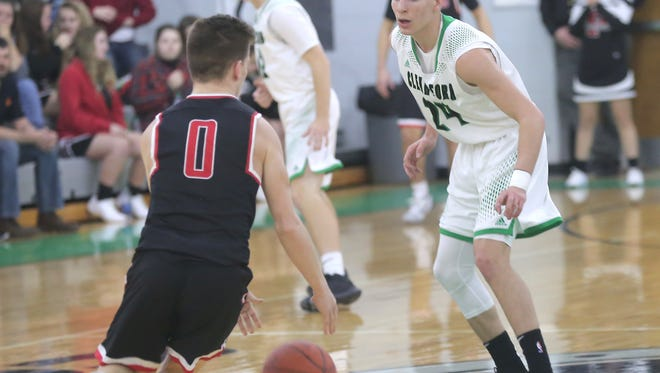 Clear Fork's Brennan Smith keeps an eye on Pleasant's Patrick Blubaugh during a home game on Friday.
