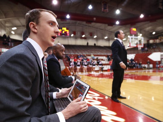 Park Tudor team manager Andrew Stickney keeps stats during the Marion County Boys Tournament second round game against Southport, Jan. 14, 2015. The school uses the stats for a video/stat system.