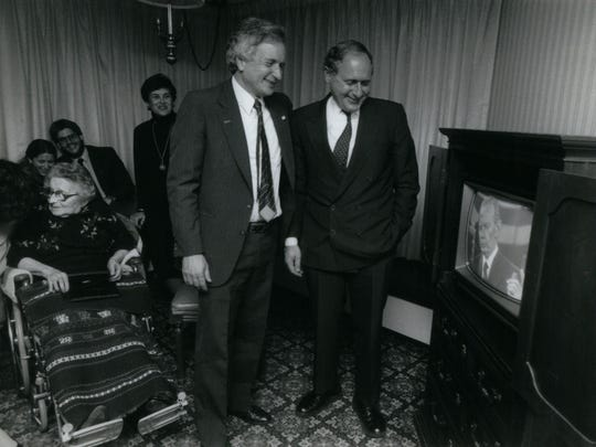 Carl Levin, Democratic U.S. senator from Michigan, watches an election telecast with his brother Sander. Sander Levin had been elected to the U.S. Senate in 1978.