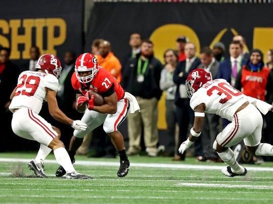 Georgia running back Nick Chubb runs the ball after