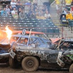 Participants compete in Sunday's demolition derby during the 2013 Wausau Area Jaycees Fourth of July Celebration at Marathon Park in Wausau.