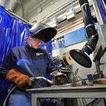 Student Debi White, 26, of Wausau, welds to join two pieces of beam metal during a welding class at Northcentral Technical College in Wausau.