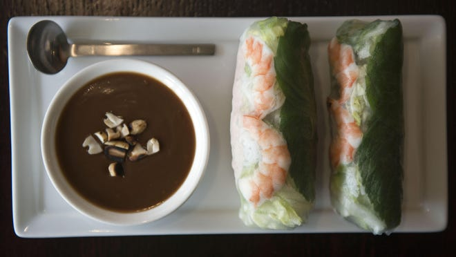The Wild Ginger Spring Rolls with shrimp, cucumber, mint, thai basil, lettuce, rice, noodles with a serving of Peanut Sauce. Wild Ginger is located at 1959 Hendersonville Rd in Biltmore Forrest.
