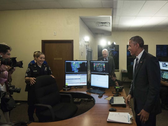 President Barack Obama chastizes the press pool for having forced Sgt. Linda Alicea from her workstation as he tours the Real-Time Tactical Operational Intelligence Center at the Camden County Police Department headquarters on May 18. Just two weeks later, Alicea became the first Latina woman promoted to lieutenant in the department.
