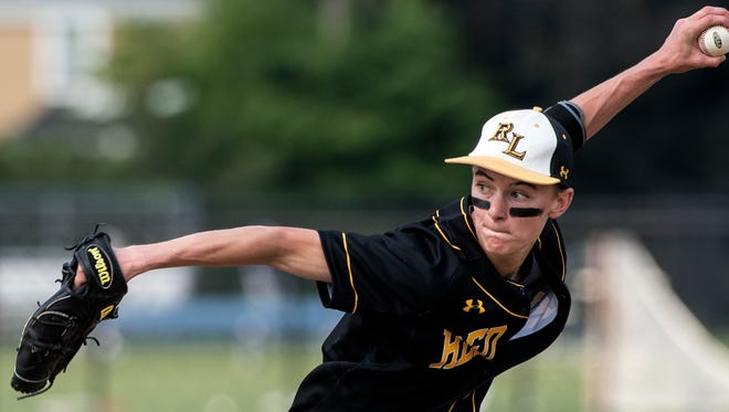 Red Lion pitcher Tyler Stabley gets set to deliver a pitch to a La Salle batter during the PIAA Class 6A quarterfinals in Manheim Township, Thursday, June 7, 2018. The La Salle College Explorers beat the Red Lion Lions 13-0, ending Red Lion's season. during the PIAA Class 6A quarterfinals in Manheim Township, Thursday, June 7, 2018. The La Salle College Explorers beat the Red Lion Lions 13-0, ending Red Lion's season.
