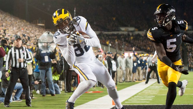 Michigan wide receiver Amara Darboh makes a catch in the end zone ahead of Iowa defensive back Manny Rugamba but was ruled out of bounds in the first quarter.
