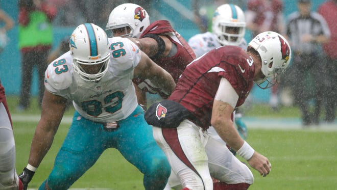 Arizona Cardinals quarterback Carson Palmer (3) fumbles the ball as Miami Dolphins defensive tackle Ndamukong Suh (93) attempts to recover it, during the first half of an NFL football game, Sunday, Dec. 11, 2016, in Miami Gardens, Fla.
