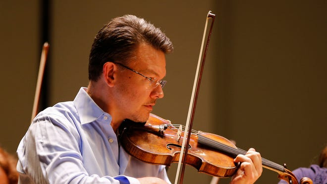 Timothy Lees, pictured, Tuesday, March 7, 2017, at the Taft Theatre, the first violinist of the Cincinnati Symphony Orchestra, is making his return to the group following surgery.