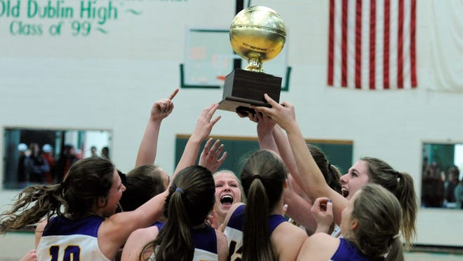 The Wylie girls basketball team lifts the Region I-4A area championship trophy following its 63-46 Region I-4A area playoff victory against Midlothian Heritage at Dublin on Friday, Feb. 16, 2018.