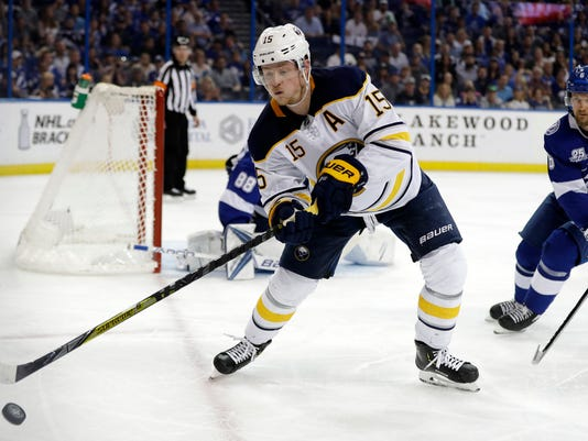 Buffalo Sabres center Jack Eichel (15) goes for the puck in front of Tampa Bay Lightning defenseman Anton Stralman (6) during the third period of an NHL hockey game Friday, April 6, 2018, in Tampa, Fla. (AP Photo/Chris O'Meara)