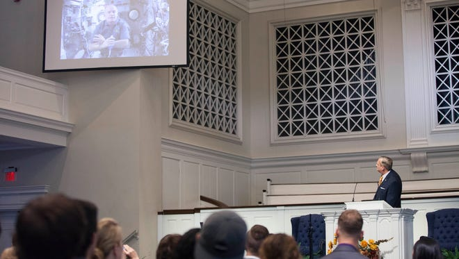 Southern Seminary President R. Albert Mohler Jr. interviews NASA astronaut Jeff Williams through a downlink interview during an Aug. 30 chapel service.