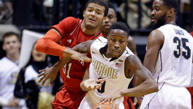 Purdue guard Jon Octeus (0) strips the ball from Nebraska forward Shavon Shields (31) in the first half of an NCAA college basketball game in West Lafayette, Ind., Sunday, Feb. 15, 2015. (AP Photo/Michael Conroy)