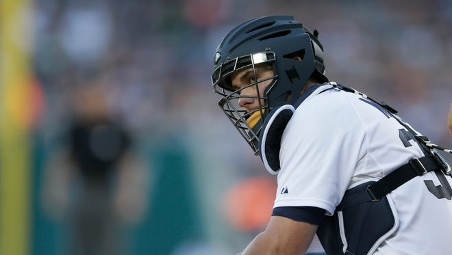 Detroit Tigers catcher James McCann looks towards the bench during the first inning of a baseball game against the Boston Red Sox, Friday, Aug. 7, 2015, in Detroit.