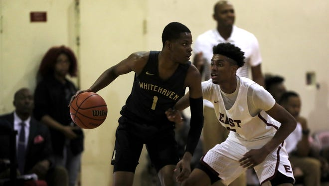 Ryan Boyce (guarding Whitehaven's Cam Jones) led East with 22 points Friday.