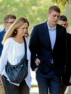 Brock Turner, right, makes his way into the Santa Clara Superior Courthouse in Palo Alto, Calif.