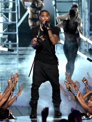 Singer Trey Songz performs onstage during the BET AWARDS '14 at Nokia Theatre L.A. LIVE on June 29, 2014 in Los Angeles, California.