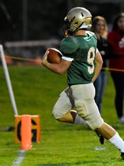 York Catholic's Kyle Dormer scores a touchdown during football action against Susquehannock at York Catholic High School in York City, Friday, Sept. 8, 2017. York Catholic would win the game 27-17. The Fighting Irish are one win away from earning a share of the Division III title with Littlestown. Dawn J. Sagert photo