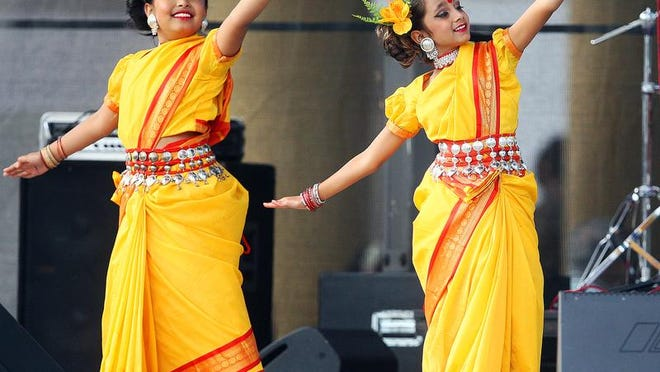 Tasfia Howlader, 8, and Sahira Uddin, 9, perform during the Banglafest cultural event Saturday at Centennial Park in downtown Fort Myers.