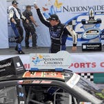 Chris Buescher celebrates after winning the NASCAR Nationwide Series Nationwide Children's Hospital 200 auto race at Mid-Ohio Sports Car Course on Saturday in Lexington, Ohio.