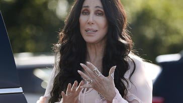 In a Sunday, Aug. 21, 2016 file photo, singer and actress Cher stops to talk to media as she leaves a fundraiser for Democratic presidential candidate Hillary Clinton at the Pilgrim Monument and Provincetown Museum in Provincetown, Mass. Cher is returning to the stage in 2017 for a series of performances on both sides of the country. The pop legend's residency, launches Feb. 8 in Las Vegas.