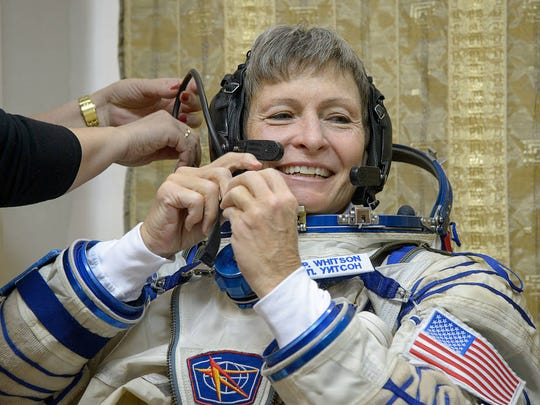 NASA astronaut Peggy Whitson, a native of Iowa, dons her Sokol suit ahead of her final qualification exams at the Gagarin Cosmonaut Training Center in Star City, Russia.