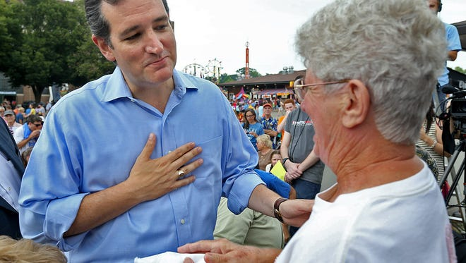 U.S. Sen. Ted Cruz of Texas respectfully declines the offer of a cheese curd from Karen VerSteeg, 74, of Runnells, before taking the stage Saturday at The Des Moines Register Political Soapbox at the Iowa State Fair on Saturday.