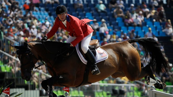 Brewster's Mclain Ward, riding Azur, competes in the equestrian jumping competition at the 2016 Summer Olympics in Rio de Janeiro, Brazil, Sunday, Aug. 14, 2016.