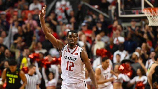 Texas Tech's Keenan Evans reacts after making a 3-pointer basket during the game against Baylor.