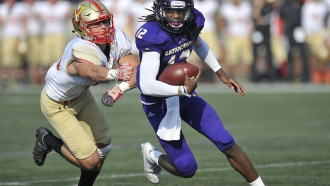 Western Carolina quaretrback Tyrie Adams picks up yardage in a second quarter drive against the VMI Keydets on Saturday in Cullowhee.