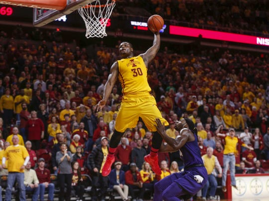 Iowa State senior Deonte Burton is fouled on a dunk by Kansas State's D.J. Johnson on Jan. 24, 2017, at Hilton Coliseum in Ames. The Cyclones won, 70-65.