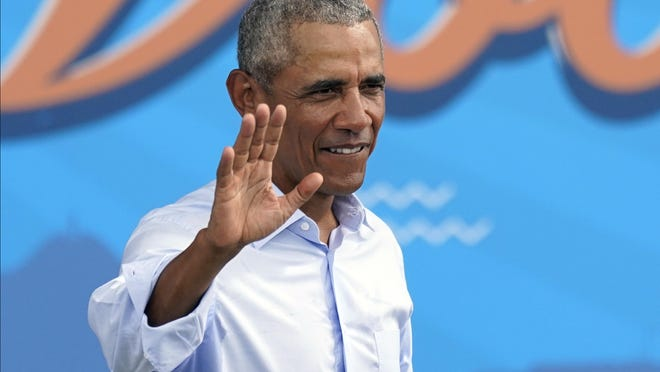 Former President Barack Obama waves to supporters as he leaves a rally while campaigning for Democratic presidential candidate former Vice President Joe Biden Tuesday, Oct. 27, 2020, in Orlando, Fla.