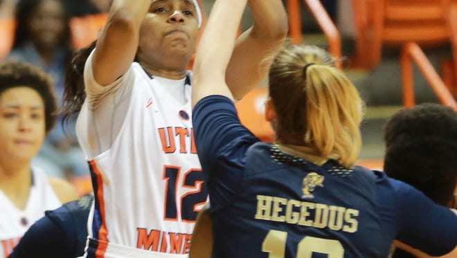 UTEP's Sparkle Taylor scores over FIU defender Janka Hegedus recently. Taylor earned second team All-Conference USA honors.